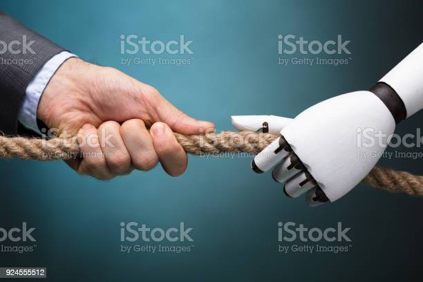 Businessperson and robot playing tug of war picture id924555512?b=1&k=6&m=924555512&s=612x612&h=hkctfguin3jenycdwbechdmvwmgtfsnlacbzd0udebo=