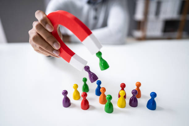 Businessperson Attracting Pawn Figures With Horseshoe Magnet Hand Holding Red Horseshoe Magnet Attracting Pawn Figures memories stock pictures, royalty-free photos & images