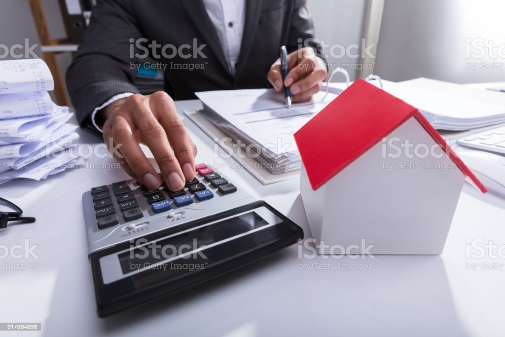 Businessperson Calculating Bill In Office stock photo
