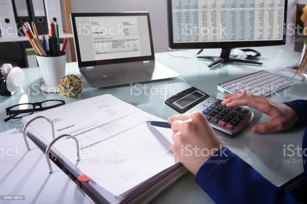 Businessperson Calculating Invoice royalty-free stock photo