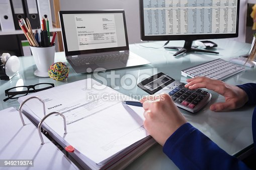 istock Businessperson Calculating Invoice 949219374