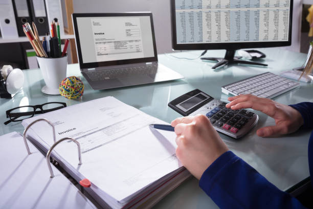 businessperson calculating invoice - stock broker stock photos and pictures