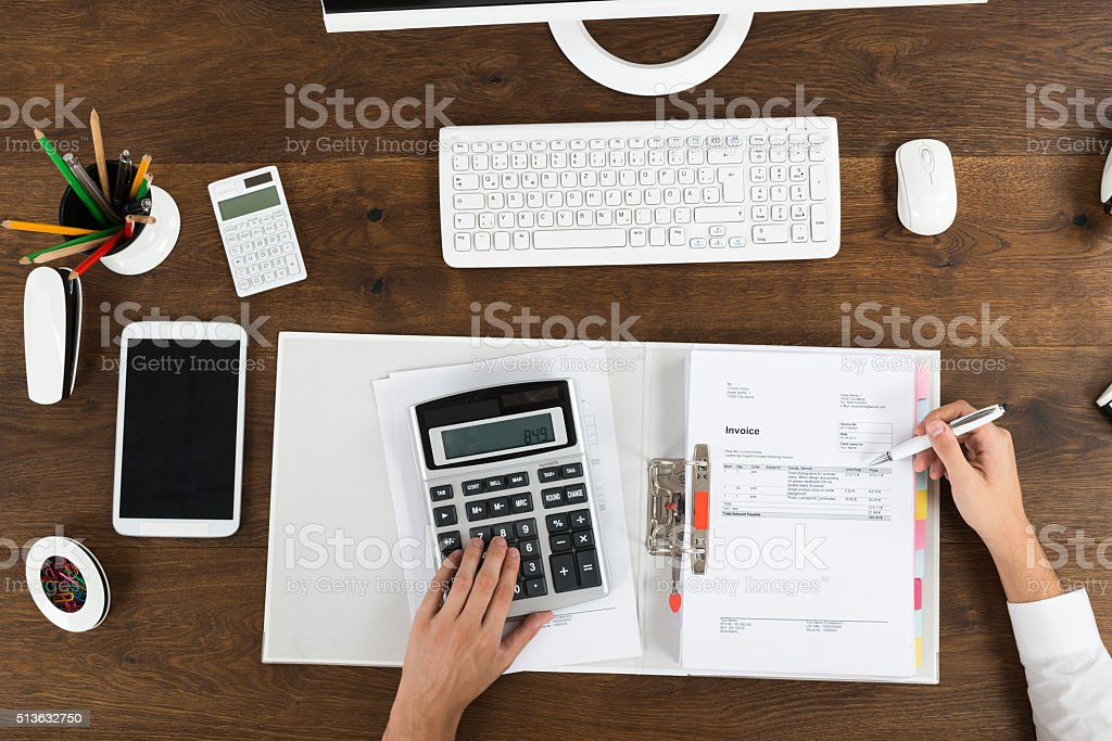 Businessperson Calculating Tax stock photo