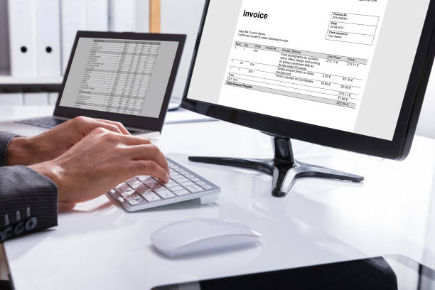 businessperson checking invoice on computer - form document stock pictures, royalty-free photos & images