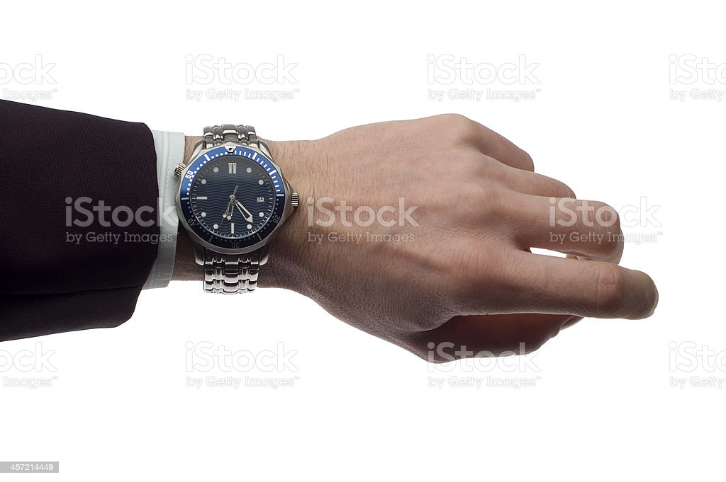 Businessperson displaying a silver and blue wristwatch stock photo