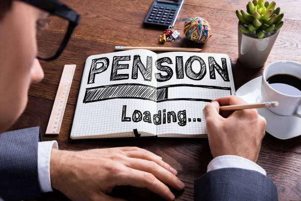 Businessperson Drawing Loading Pension Concept On Notebook Businessperson Drawing Loading Pension Concept On Notebook pension stock pictures, royalty-free photos & images