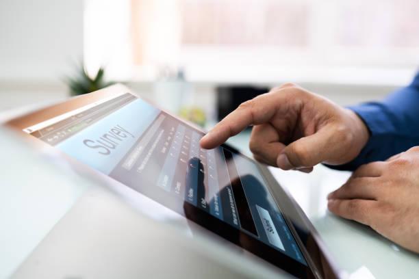Businessperson Filling Online Survey Form stock photo