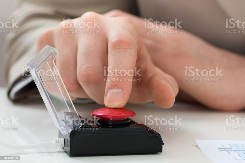 Businessperson Hand Pressing Emergency Button stock photo