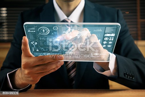 istock businessperson holding futuristic information device. graphical user interface(GUI). internet of things. 858499326