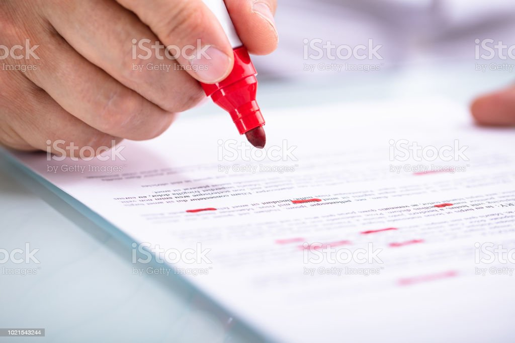 Businessperson Holding Marker On Document stock photo