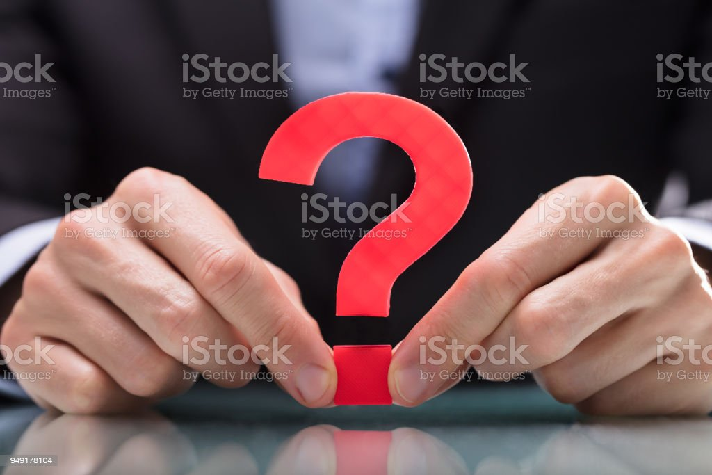 Businessperson Holding Question Mark Sign stock photo