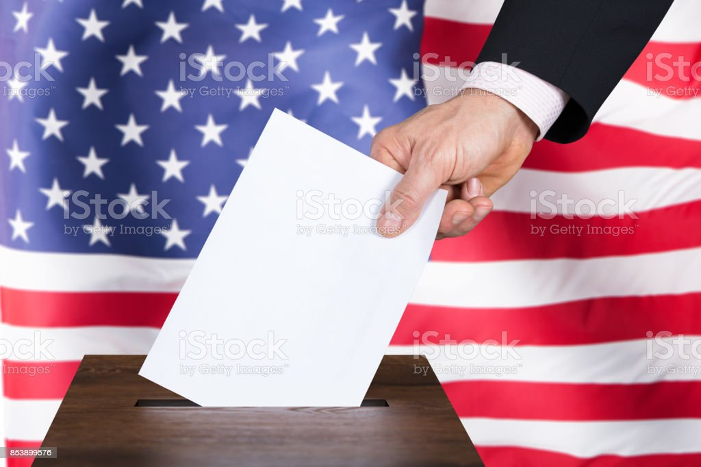 Businessperson Inserting Ballot In Box stock photo