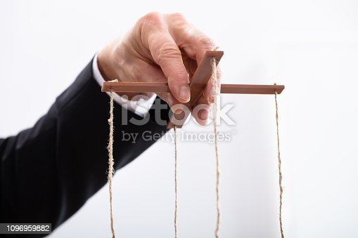 istock Businessperson Manipulating Marionette 1096959882