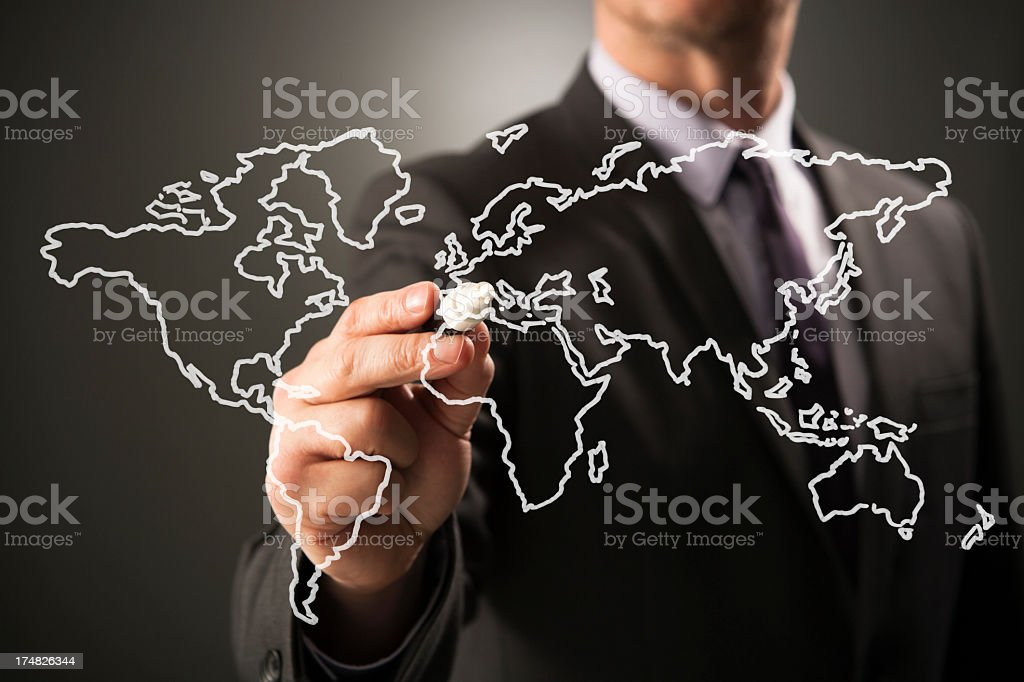 Businessperson marking area on transparent world map royalty-free stock photo