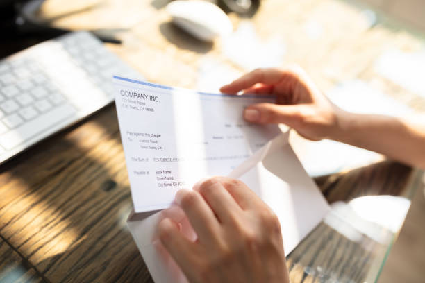 businessperson opening envelope with paycheck - group of people стоковые фото и изображения