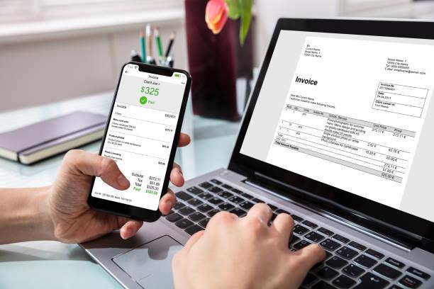 businessperson paying invoice on mobilephone - bolletta foto e immagini stock
