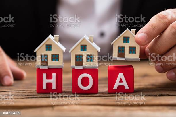 Businessperson placing house model over hoa blocks picture id1000964732?b=1&k=6&m=1000964732&s=612x612&h=m chs0vrzvic8nk4fkhfywh xb ef10loxshbfukgxe=