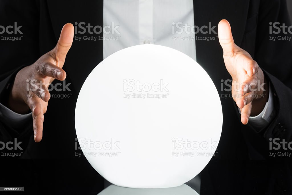 Businessperson Predicting Future With Crystal Ball stock photo