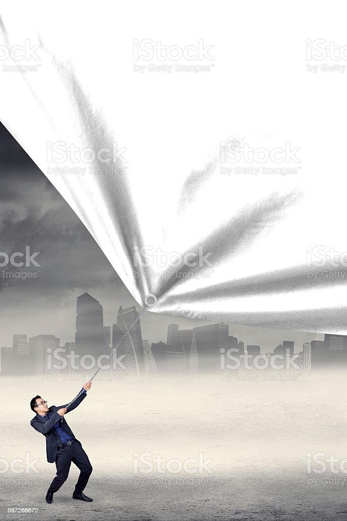 Businessperson pulling blank banner royalty-free stock photo