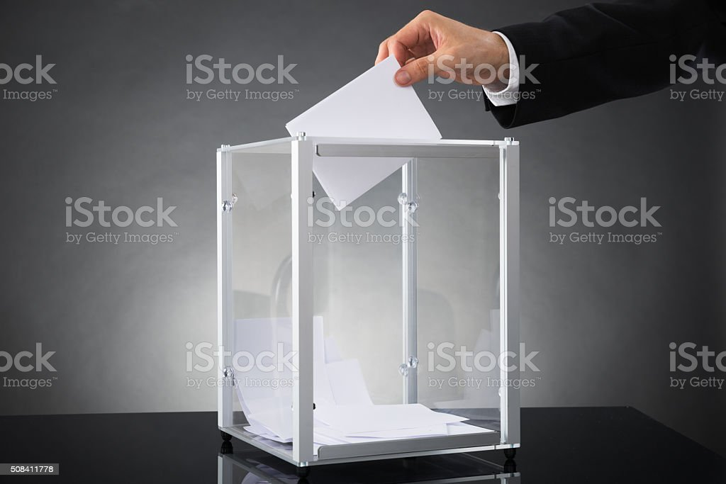 Businessperson Putting Ballot In Box stock photo