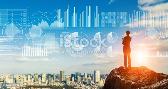 904389218istockphoto Businessperson standing on the mountain top. Strategy of business concept. 1204762200