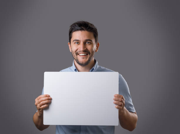 Businessperson with white empty cardboard stock photo