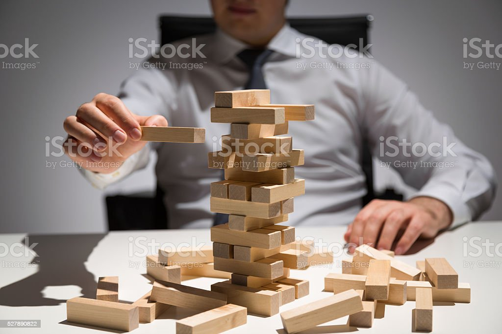 Businessperson wooden blocks desk stock photo