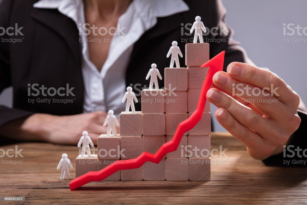 Businessperson's Hand Holding Red Arrow stock photo