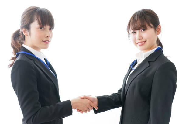 businesspersons 手を振る - ビジネスフォーマル ストックフォトと画像