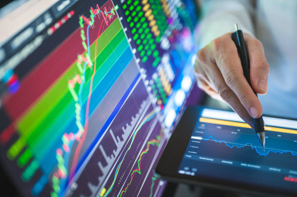 Businesssman using Chart and graph to trading in stock and cryptocurrency after blobal businesss going to bullmarket after Recession stock photo