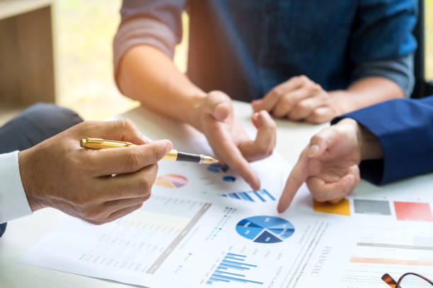 businessteam are meeting planning,office workers are analyzing graphs. - graphic print stock photos and pictures