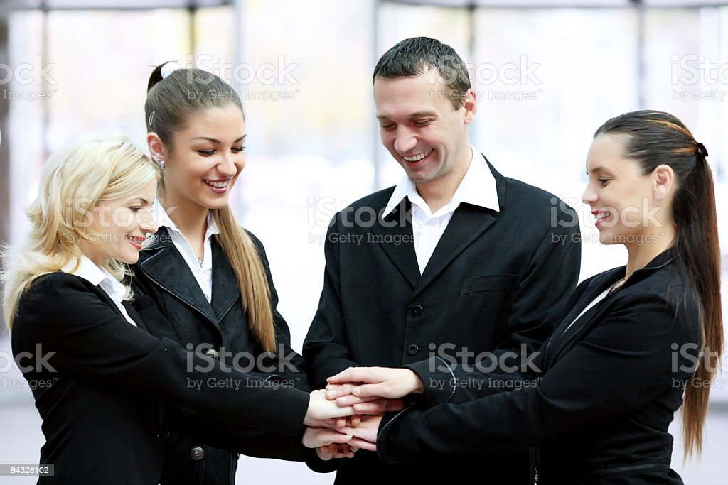 Business-team holding hands on top of each other. royalty-free stock photo
