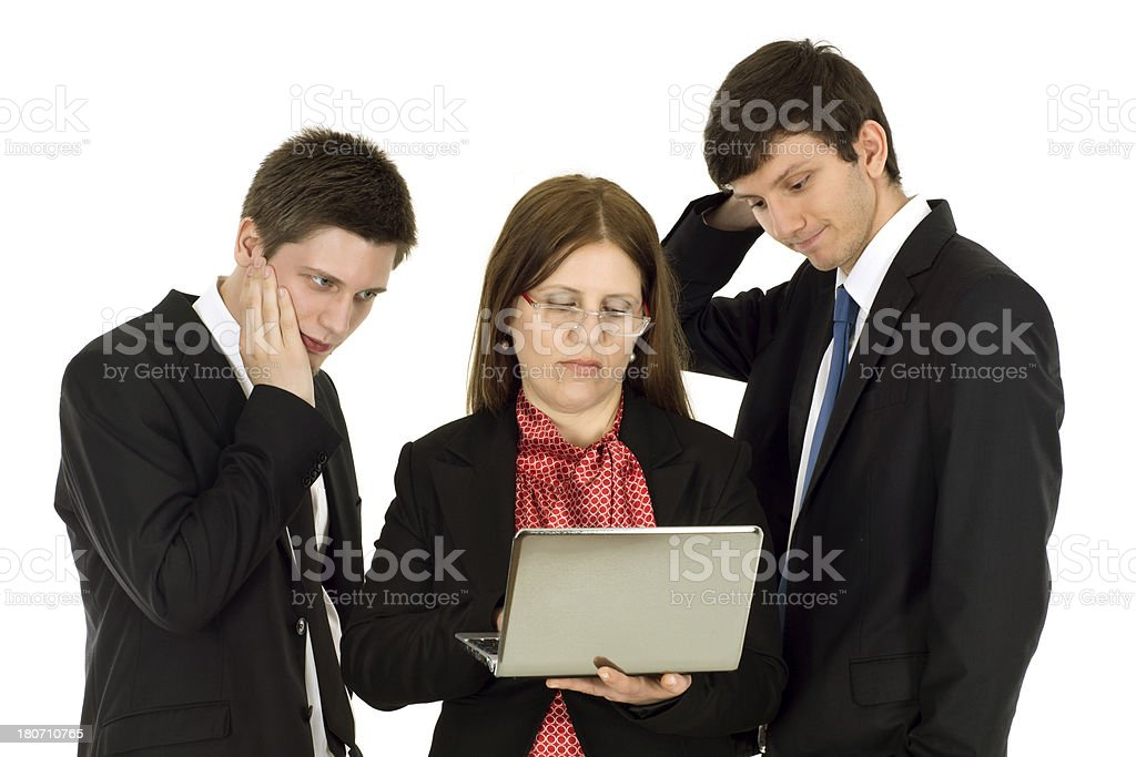 Businessteam look nervously into his laptop screen royalty-free stock photo