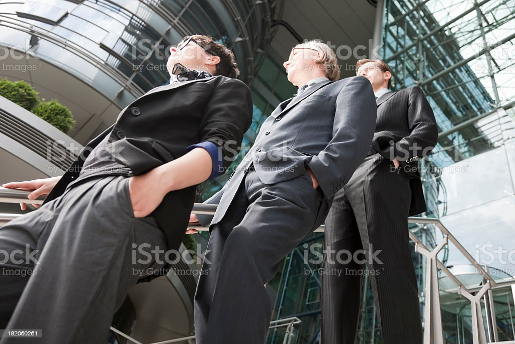 Businessteam of Three Persons Outside Glass Office Building royalty-free stock photo
