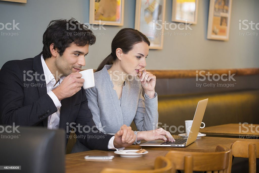 Businessteam working on laptop at coffee bar royalty-free stock photo