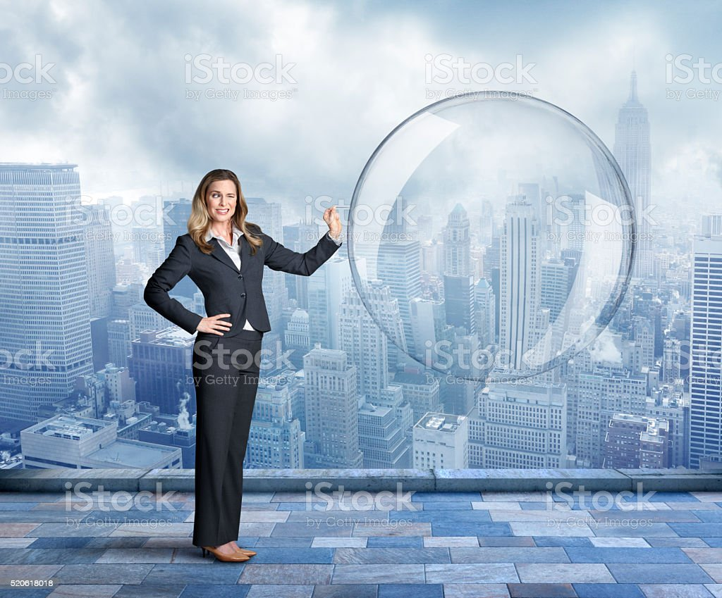 Businesswoman About To Pop Large Bubble stock photo