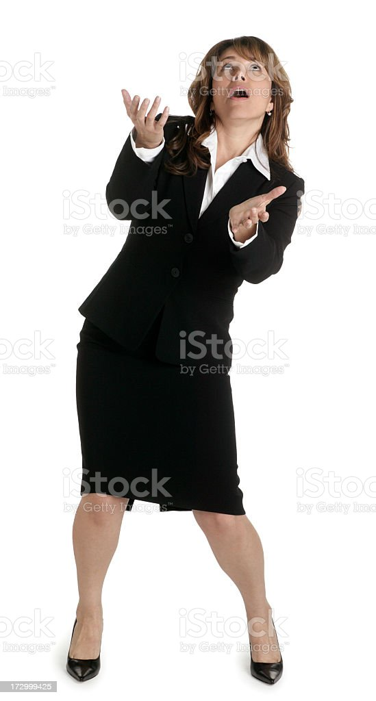 Businesswoman acting like she is juggling something royalty-free stock photo