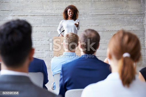 istock Businesswoman Addressing Delegates At Conference 505595358