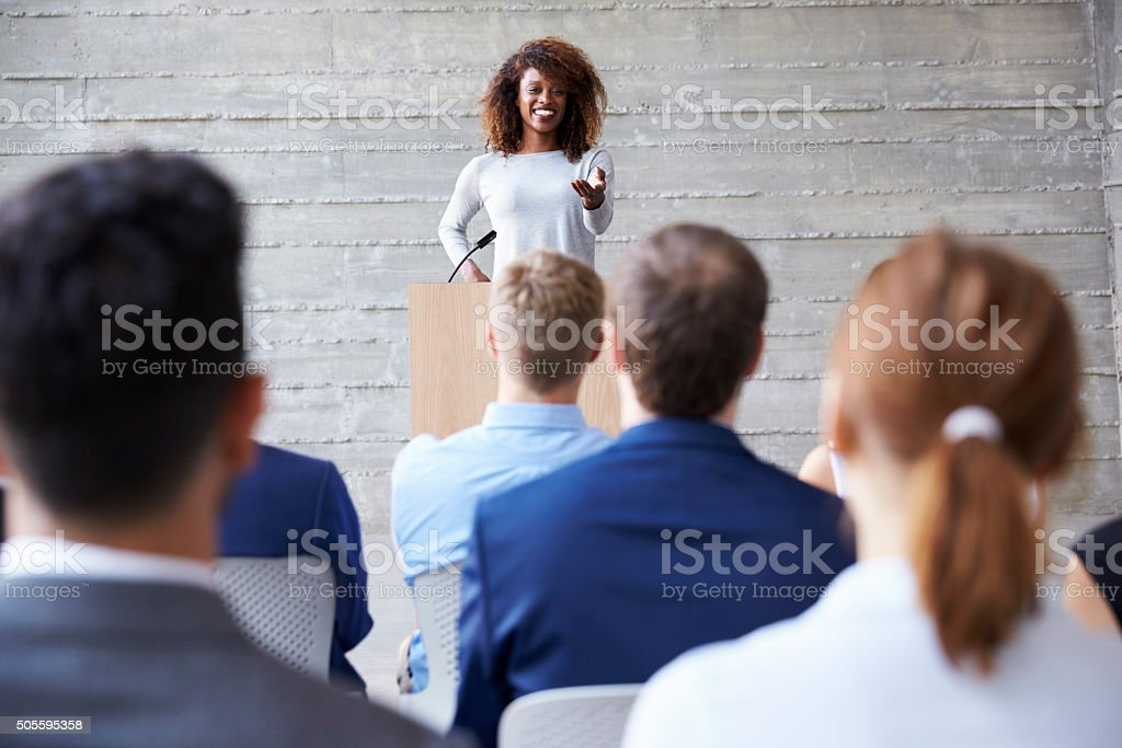 Businesswoman Addressing Delegates At Conference stock photo