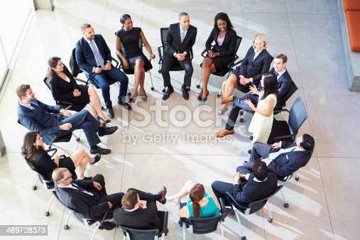 504879112istockphoto Businesswoman addressing employees at a staff meeting 469728373