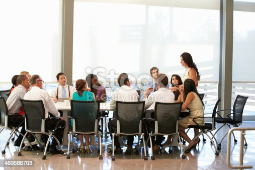 504879112istockphoto Businesswoman Addressing Meeting Around Boardroom Table 469586703