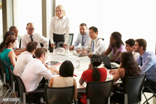 504879112istockphoto Businesswoman Addressing Meeting Around Boardroom Table 469723021