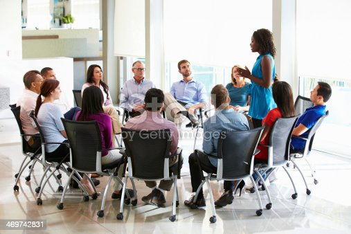 504879112istockphoto Businesswoman Addressing Multi-Cultural Office Staff Meeting 469742831