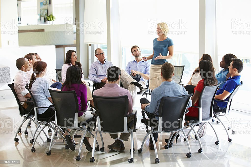 Businesswoman Addressing Multi-Cultural Office Staff Meeting stock photo