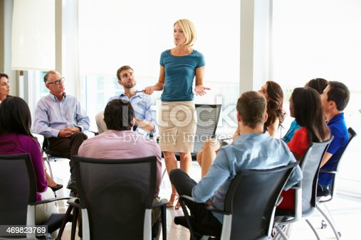 504879112istockphoto Businesswoman Addressing Multi-Cultural Office Staff Meeting 469823769