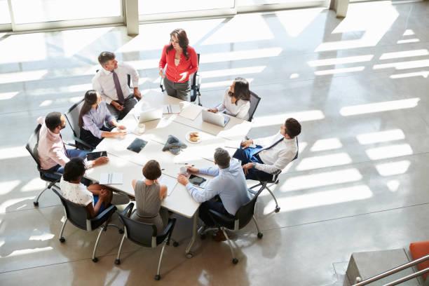 Businesswoman addressing team meeting elevated view picture id998338578?b=1&k=6&m=998338578&s=612x612&w=0&h= 6rmdsdptjx0zwbqs9opi7nswc1t3qg1hg7tjqkqq64=