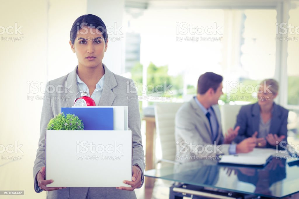 Businesswoman after being let go stock photo