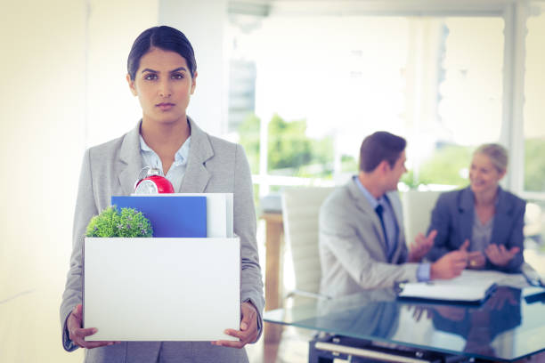 businesswoman after being let go - leaving partnership corporate business sitting stock photos and pictures