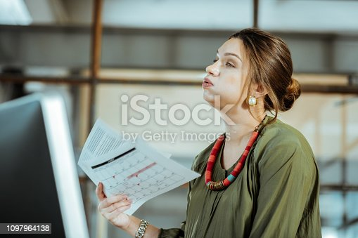 istock Businesswoman after working in the office without air conditioning 1097964138
