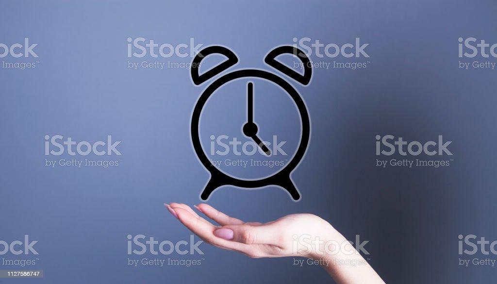businesswoman alarm clock stock photo